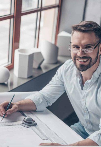 Smiling mature engineer at work in studio