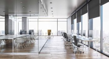 Luxury glass concrete office interior with city view, daylight, wooden floor furniture and equipment. 3D Rendering